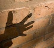 Sombra de la mano imagenes de archivo