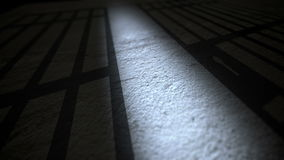 Sombra de las barras de la cárcel