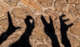 sombra de las manos Imagenes de archivo