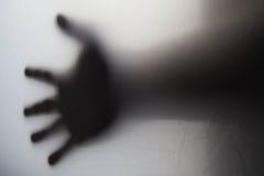 Sombra de una falta de definición de la silueta de la mano Foto de archivo libre de regalías
