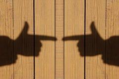Sombra de una mano con un dedo índice Fotos de archivo