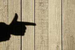 Sombra de una mano con un dedo índice Fotos de archivo libres de regalías