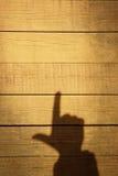 Sombra de una mano con un dedo índice Imagen de archivo