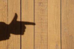 Sombra de una mano con un dedo índice, imagen de XXXL con el espacio libre Fotos de archivo libres de regalías