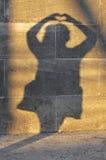 sombra de una mujer con el corazón Fotografía de archivo libre de regalías