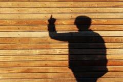 Sombra de una mujer que gesticula con su mano Fotografía de archivo