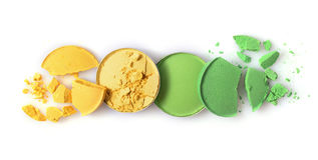 A sombra deixada de funcionar amarela e verde redonda para compõe como a amostra de produto cosmético Imagens de Stock