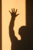 Sombra del hombre en una pared Fotografía de archivo libre de regalías