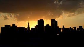 Sombra del horizonte de Nueva York en la puesta del sol fotografía de archivo