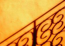 Sombra do cerco na parede Fotos de Stock Royalty Free