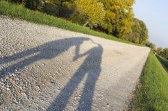 Sombra do coração na estrada Fotografia de Stock