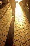 Sombra en la acera Foto de archivo libre de regalías