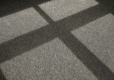 Sombra en una moqueta Fotos de archivo