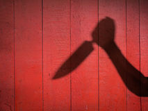 Sombra masculina da mão com faca de cozinha Imagem de Stock Royalty Free