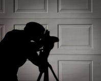 A sombra ou a silhueta do fotógrafo Fotografia de Stock