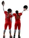 Sombras da menina das mulheres do adolescente dos jogadores de futebol americano isoladas Fotos de Stock Royalty Free