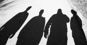 Sombras de cuatro personas Imágenes de archivo libres de regalías