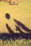 Sombras de la familia Fotografía de archivo