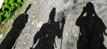 Sombras dos caminhantes em um passeio na montanha Foto de Stock