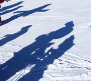Sombras dos esquiadores na neve Imagem de Stock Royalty Free