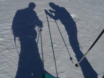 Sombras dos esquiadores na neve Foto de Stock Royalty Free
