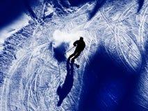 Sombras dos esquiadores na neve Imagem de Stock