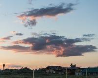 Sombras em nuvens do por do sol sobre a praia Fotografia de Stock