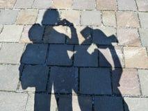 Sombras em um trajeto dos turistas que tomam fotos Foto de Stock Royalty Free