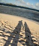 Sombras en una playa Imágenes de archivo libres de regalías