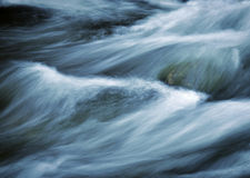 Sombre background fierce rapids on the river Stock Images