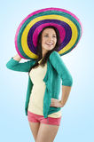 The sombrero. Young and pretty brunette woman with colored dress and a big hat full color stock image