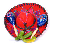 Sombrero. Mexican sombrero with chiles and maracas Royalty Free Stock Photography