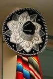 Sombrero. A sombrero and a Mexican traditional carpet on a door Royalty Free Stock Photos