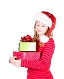 Sombrero adolescente de Papá Noel que lleva que lleva a cabo regalos de Navidad Imagen de archivo