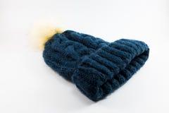 Sombrero azul de las lanas en el fondo blanco Fotografía de archivo libre de regalías