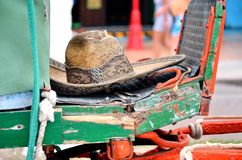 Sombrero and cab. Old sombrero and cab in mexico stock photography