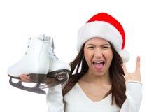 Sombrero de Ñhristmas santa de los patines de hielo de la muchacha que grita Foto de archivo