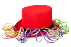 Sombrero de copa rojo con los bobinadores de cintas en modo continuo Fotografía de archivo libre de regalías