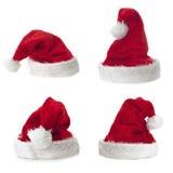 Sombrero de cuatro Santa Claus en el fondo blanco Fotos de archivo