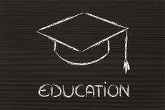 Sombrero de la graduación y escritura de la educación Fotografía de archivo