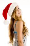 Sombrero de la Navidad de la muchacha linda del adolescente que desgasta Fotos de archivo