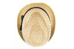 Sombrero de paja bonito con el lado superior de la cinta en el fondo blanco Fotos de archivo