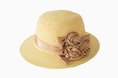 Sombrero de paja bonito con la flor en fondo del blanco del aislante Foto de archivo