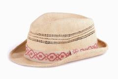 Sombrero de paja de Panamá aislado en blanco Foto de archivo