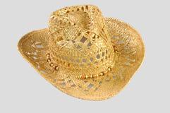 Sombrero de paja del vaquero aislado en fondo gris imagen de archivo