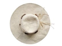 Sombrero de paja del verano en el fondo blanco - visión superior Fotografía de archivo libre de regalías