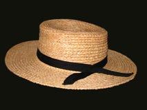 Sombrero de paja en fondo negro Fotos de archivo libres de regalías