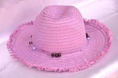 Sombrero de paja rosado Fotos de archivo libres de regalías