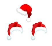 Sombrero de Papá Noel de tres rojos Fotos de archivo libres de regalías