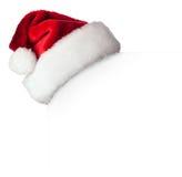 Sombrero de Papá Noel en el cartel Fotos de archivo